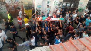תהלוכת ניצחון ברחובות עם גופת המחבל