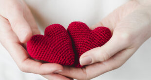crop-hands-with-knitted-hearts_23-2147736882